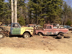 GMC 4x4 vs. Ford F-100 (sixty8panther) Tags: door new old blue trees green ford 1969 wheel yellow metal pine forest truck 1971 ancient woods rust gm paint open 4x4 duty engine rusty 4wd pickup f100 hampshire spray 63 rusted frame 1967 trucks motor 1970 1960s 1968 plow heavy 1972 scrap 1962 gmc ironoxide v8 62 harlequin 1961 2500 4wheeldrive 1963 61 wilton fordpickup integrated mrplow junked f250 oldtrucks superduty plowtruck sooc 72gmc unibody 69gmc blanchardsautosalvage harlequingmc