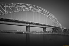 Silver Jubilee Bridge (Iain Jaques) Tags: blackandwhite infrastructure railwaybridge runcorn thebridge roadbridge rivermersey silverjubileebridge througharchbridge iainjaques manchestershippingcanal
