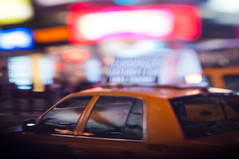 Speeding through (daniellih) Tags: new york city nyc newyorkcity light urban newyork blur color car modern night square landscape march miniature movement blurry colorful downtown cityscape dof traffic time bokeh cab taxi free shift timesquare scape tilt urbanscape 2012 lensing tiltshift freelensing daniellih