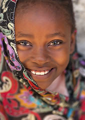 Portrait Of A Cute Girl In Lamu, Kenya (Eric Lafforgue) Tags: africa portrait color cute beauty vertical island photography pretty kenya islam hijab culture unescoworldheritagesite teenager afrika tradition lamu happyface swahili afrique adolescence eastafrica 1617years qunia lamuisland lafforgue oneteenagegirlonly traveldestination africanethnicity kenyaafrica 110071 onegirlonly muslimislam  smilingsmile qunia islamicveil    kea 1415years exterioroutdoors   tradingroute blackethnicity a beautifulcutepretty