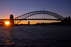 Sydney Harbour Bridge at Sunset (missgeok) Tags: lighting sunset sky orange sun water composition evening day colours sydney silhouettes australia circularquay clear sunrays popular beautifulview gettyimages touristspot lateafternoon sunflare waterreflections theblues warmcolours