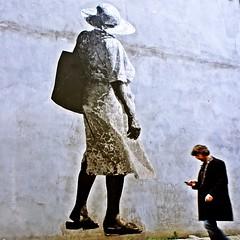 gulliver's travels (japanese forms) Tags: streetart man pastedpaper wall square graffiti stencil wheatpaste squareformat oblivious jonathanswift gulliverstravels strasenfotografie sonyαnex5 ©japaneseforms2012 mantextingtweetingfacebookingorwhatever