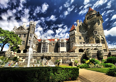 Casa Loma Castle (` Toshio ') Tags: blue sky house toronto canada building tree home fountain grass architecture clouds garden european rich polarizer bushes casaloma toshio casalomacastle