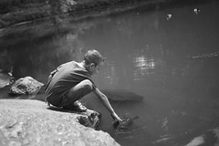 Happiness. (Brenna.W) Tags: leica nyc newyorkcity blackandwhite bw lake ny newyork black water animal animals pond child emotion turtle centralpark ducks happiness turtles innocence tortuga littleboy turtlepond m9 leicam9