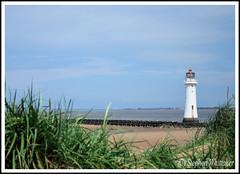 Perch Rock Lighthouse (Stephen Whittaker) Tags: blue sky people cloud lighthouse water grass sunshine rock river nikon fort pov sunny perch mersey sandhill breakwater newbrighton merseyside d5100 whitto27