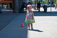 girl in a pink hat (Eyesplash - Summer was a blast, for 6 million view) Tags: old sun sunlight man black bird girl hat rock toy stand furry soft babies child dress little fuzzy low chinese feathers mother ducklings cups alleyway heat characters panting lettering crow curb raccoons wheelbarrow fstop thisoldguywasfeaturedonmikemccardellsspotonglobaltv