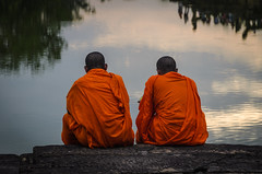 By the Water (Brian Hammonds) Tags: camera travel light sunset two orange color reflection men tourism water beautiful contrast dark asian religious temple photography photo ancient nikon scenery asia cambodia cambodian sundown bright pair religion thoughtful vivid angkorwat tourist east adventure monks thinking traveling southeast angkor wat moat complex though robes d7000