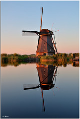 Kinderdijk Waterreflections (meypictures) Tags: travel sunset netherlands windmill photoshop mirror nikon sonnenuntergang nikkor kinderdijk niederlande windmhle photomatix wasserspiegelung watereflection d5000