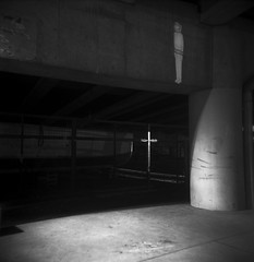 Spaceman (Zeb Andrews) Tags: city urban film night oregon square portland holga cross human kodaktrix bluemooncamera