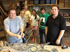 Volunteers building neon cranes
