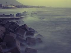 Il mare impetuoso al tramonto... (yattaran72) Tags: sea storm fall rain digital pen long exposure mare waves olympus autunno pioggia zuiko salerno epl1