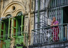 Woman In The Old Colonial Dictrict, Rangoon, Myanmar (Eric Lafforgue Photography) Tags: city people house color colour building english tourism horizontal architecture outdoors photography asia day balcony yangon burma colonial citylife myanmar oldfashioned rangoon capitalcities colonialbuilding traveldestinations colorimage onewomanonly colonialstyle buildingexterior badcondition builtstructure colourpicture traditionallymyanmarian