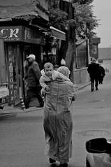 motherhood (ilmikadim) Tags: street people bw baby black turkey walking child outdoor mother istanbul motherhood magnum samatya
