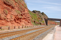 Tracks at Dawlish (basswulf) Tags: cliff red orange martian stone tracks rails railway d40 1855mmf3556g lenstagged unmodified 32 image:ratio=32 permissions:licence=c 20160504 201605 3008x2000 devon england uk