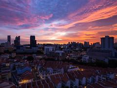 Divine Light (wkngw) Tags: city pink blue sunset sky urban sun singapore cityscape burst urbanarchitecture m43 em10 mft