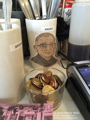 Walleyed Sartre, on the Tip Jar at the Caf Adjoining Shakespeare and Company (Doyle Wesley Walls) Tags: caf photo coins drawing thinker photograph tips bookmarks writer knives spoons philosopher literaryfigure lagniappe jeanpaulsartre frenchauthor frenchphilosopher 2375 smartphonephoto iphonephoto doylewesleywalls