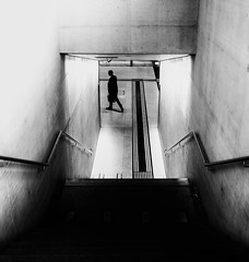 commuting (Dan-Schneider) Tags: street streetphotography schwarzweiss scene schneider silhouette shadow blackandwhite bw best zurich einfarbig monochrome minimalism moment mft olympus omdem10 light lines flickr trip metro tunnel station human photography people urban europe