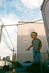 Hello? (Georgie_grrl) Tags: hello boy streetart toronto ontario man art graffiti glasses expression creative goggles figure pentaxk1000 ossingtonavenue isitmeyourelookingfor rikenon12828mm springshootingshenanigans