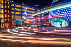 Like A Dance of Light (dolbinator1000) Tags: bull ring birmingham city centre center engalnd uk urban building buildings modern architecture light trail trails car cars bus buses orange white blue green red colour colours entrance road street winter