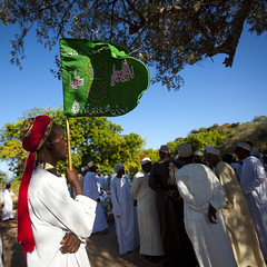 Crowd Gathering In The Lamu Cemetery Celebration Of Maulidi, Lamu, Kenya (Eric Lafforgue) Tags: africa color outdoors island photography exterior kenya flag culture unescoworldheritagesite afrika tribute tradition lamu cultural swahili afrique eastafrica baraza qunia lamuisland lafforgue traveldestination maulidi  comoran qunia   125773  kea   tradingroute blackethnicity birthoftheprophet a