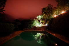 Night Pool (SteveBurnettEsq) Tags: france night reflections lights cannes dusk sony palmtrees villa tropical hillside poolside 16mm 30second nex5