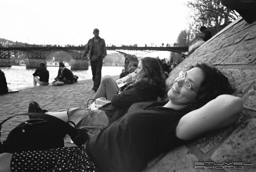 Relaxing at the embankment of the Seine