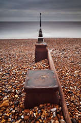 The Divide (Explored) (simon.anderson) Tags: longexposure sea seascape beach landscape sussex nikon moody dramatic pebbles explore beacon groynes bexhill 1685 explored simonanderson d300s lee09ndgrad hitechprostopper