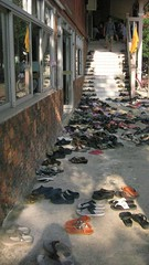 Shoes (percyverance) Tags: temple wat songkran korat lotteryticket thainewyear katae sandstupa