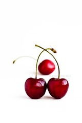 [cherries low res] (RHiNO NEAL) Tags: rhinoneal rhino neal cherry cherries red white redonwhite portrait whitbackground fruit recipe book shiny food tasty yummy sweet stalk three cherryred rhinoneil gettyimagesartistpicks