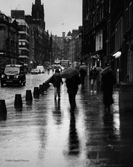 Edinburgh (vision.dance) Tags: street uk people blackandwhite blancoynegro film rain umbrella scotland edinburgh noiretblanc zwartwit taxi pedestrian ilfordhp5 schwarzweiss pretoebranco  biancoenero  ldr  pentax67   reflcction