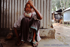 Just Another Monsoon Day (Rezwan Khan Saikat) Tags: poverty old rain living monsoon labour bangladesh