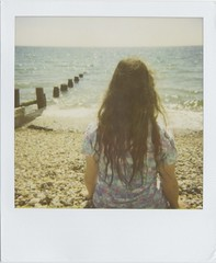 ocean colours (Lizzie Staley) Tags: ocean blue sea summer colour film beach vintage hair polaroid long waves dress turquoise sunny pebbles sparkle 1940s 600 instant glimmer bognorregis glisten supercolor670af dipdye