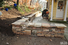WM Mark Jurus 8, retaining wall, freestanding wall. flat caps stones, dry laid stone construction, copyright 2014