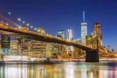City Lights (Photos By RM) Tags: new york city nyc newyorkcity longexposure bridge sunset usa newyork building skyline architecture brooklyn lights view skyscrapers bright manhattan worldtradecenter brooklynbridge lowermanhattan newyorkny slowshutterspeed brooklynbridgepark freedomtower