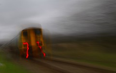 Slow Zoom (3) (howell.davies) Tags: uk abstract blur color colour art wales train movement nikon track slow heart zoom exploring rail explore shutter 1855 mdu zooming arriva hendy d3200