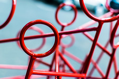 Red Metal Circles (pillarsoflight) Tags: blue red beauty lines car statue oregon 35mm portland prime aperture nikon bokeh rings adobe pdx 18 pnw lightroom wideaperture d3300