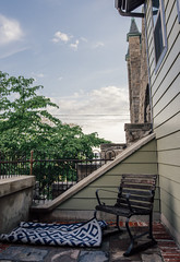 the little balcony (almostsummersky) Tags: sky house tree brick philadelphia church stone tile outside us spring chair afternoon exterior unitedstates pennsylvania balcony patio hidden condo rug converted railing manayunk condominium secluded