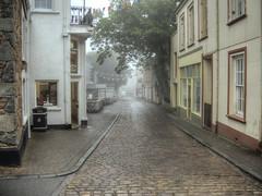 Victoria Street, Alderney in the fog (neilalderney123) Tags: street weather fog olympus alderney victoriastreet aldermey 2016neilhoward