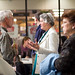 Conference participants Eileen Kinch, David Stenson, Jane Burkholder, and Grace Jones mingle at the group book signing.