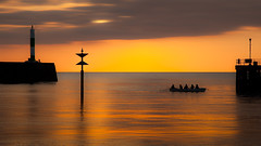 Living the dream (izzy's-photos) Tags: ocean sunset sea lighthouse blur silhouette photoshop gold pier fisherman seagull aberystwyth rowingboat harbourmouth liquidgold navigationalaid coxedfour mygearandme mygearandmepremium anotherpier