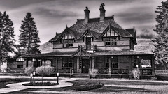 The Bow Valley Ranch House (LostMyHeadache: Absolutely Free *) Tags: trees sky blackandwhite house building heritage history classic nature grass architecture clouds contrast spring nikon estate historical mansion davidsmith calgaryalbertacanada bowvalleyranch
