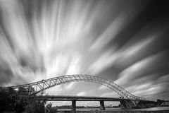 Bridge Burst (Chrisconphoto) Tags: longexposure bridge blackandwhite bw clouds movement mood le drama runcornbridge weldingglass comeonengland
