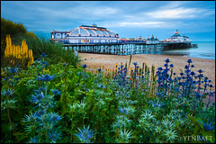 Eastbourne - Flowers at Eastbourne Pier (Yen Baet) Tags: city uk greatbritain trip travel sunset sea vacation england reflection beach water architecture photography coast pier photo twilight europe european waterfront unitedkingdom britain dusk postcard scenic eu esplanade eastbourne coastline british bluehour seafront southcoast picturesque eastsussex eastbournepier britons pleasurepier yenbaet