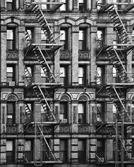 New York Cast Iron icon fire escapes - reminiscent of the cover to Led Zeppelin's album Physical Graffiti (Paul in Leeds) Tags: new york windows white black apple scale monochrome architecture fire grey big manhattan gray sone icon ironwork alpha brickwork escapes brisks a900