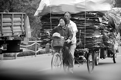 The Couple (faungg's photos) Tags: life china street people bw woman white man black asian nikon couple asia tricycle snapshot chinese beijing documentary scene daily riding bj  everyday 18200  peking  transporting   d90  faungg