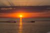 Water Skiing at Sunset (BraCom (Bram)) Tags: sunset sea sun holland reflection clouds canon boot boat zonsondergang nederland thenetherlands noordzee wolken wave zee northsea waterskiing sunrays zon ouddorp zuidholland goereeoverflakkee spiegeling waterskier zonnestralen coth brouwersdam canonef24105mm sunsetsandsunrisesgold bracom canoneos5dmkiii bramvanbroekhoven