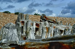 old wooden posts (The Urban Adventure) Tags: wood beach clouds 50mm sussex coast nikon bokeh harbour pebbles rye coastal naturereserve posts derelict d7000