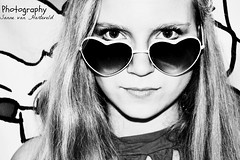 Behind the hearts. (Sannuu) Tags: portrait bw white black girl sunglasses glasses arty heart