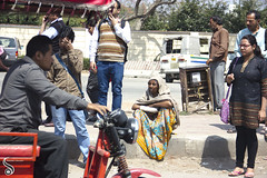 Lone in the Crowd (Shikher Singh) Tags: people man girl lady bag sweater delhi pedestrian walkway specs shawl rickshaw saree footpath bespectacled commonman shikhersimagery