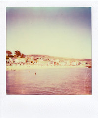 coastal (The_Last_Magnus) Tags: ocean pink blue houses sea england sky beach water vintage square landscape polaroid bay coast town sand waves cityscape purple pastel shingle retro pebble 600 dorset instant vignette impossibleproject